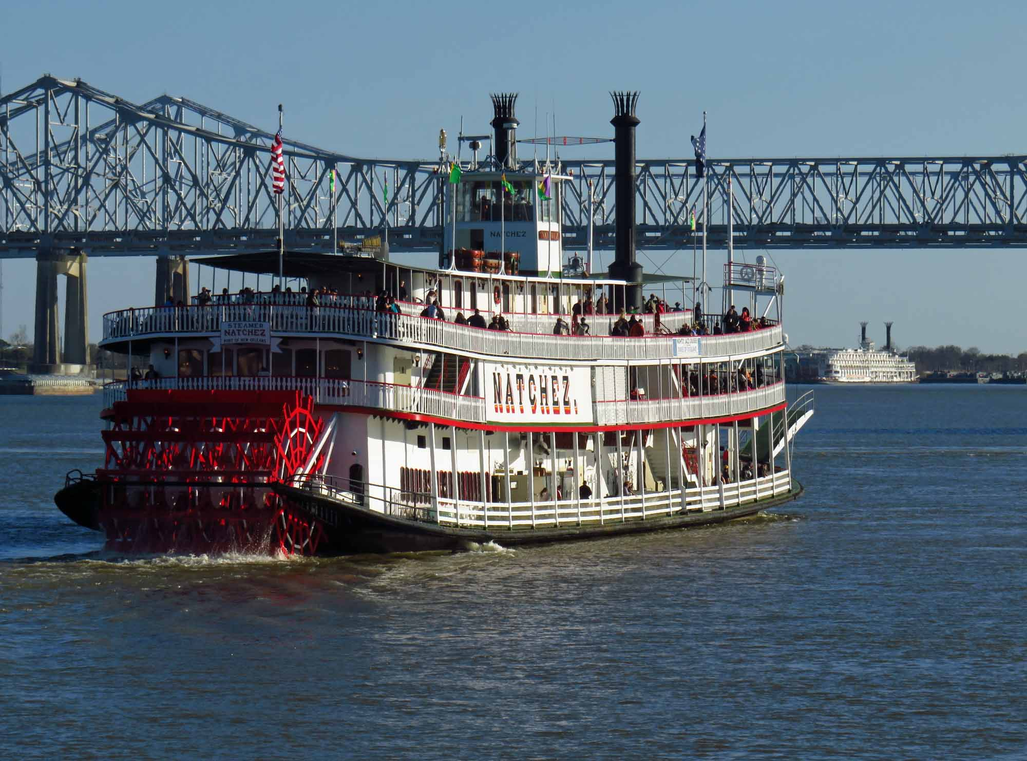 Natchez Steamboat passing by the Crescent City Bridges