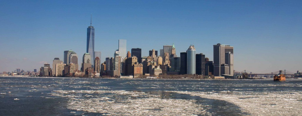 The blue sky and white floating ice set off nicely the iconic Manhattan skyline.