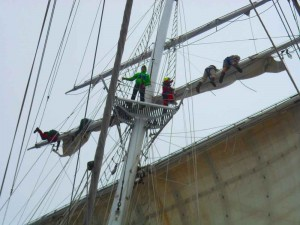 Crew working aloft on the sails