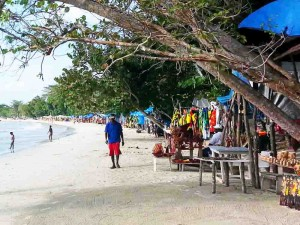 Small stalls along Bloody Bay Beach