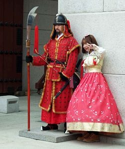 Sentry and lady dressed in Hanbok style