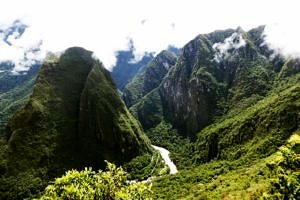 the Urubamba River threads through the narrow, steep-sided valley