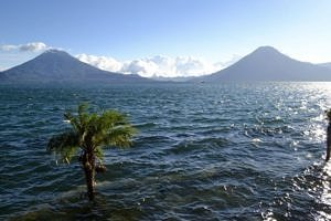 Volcanoes stand as guardians of the lake
