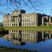 Lyme House from across the garden lake