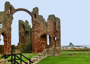 Northumberland: Lindisfarne Priory with Castle in background